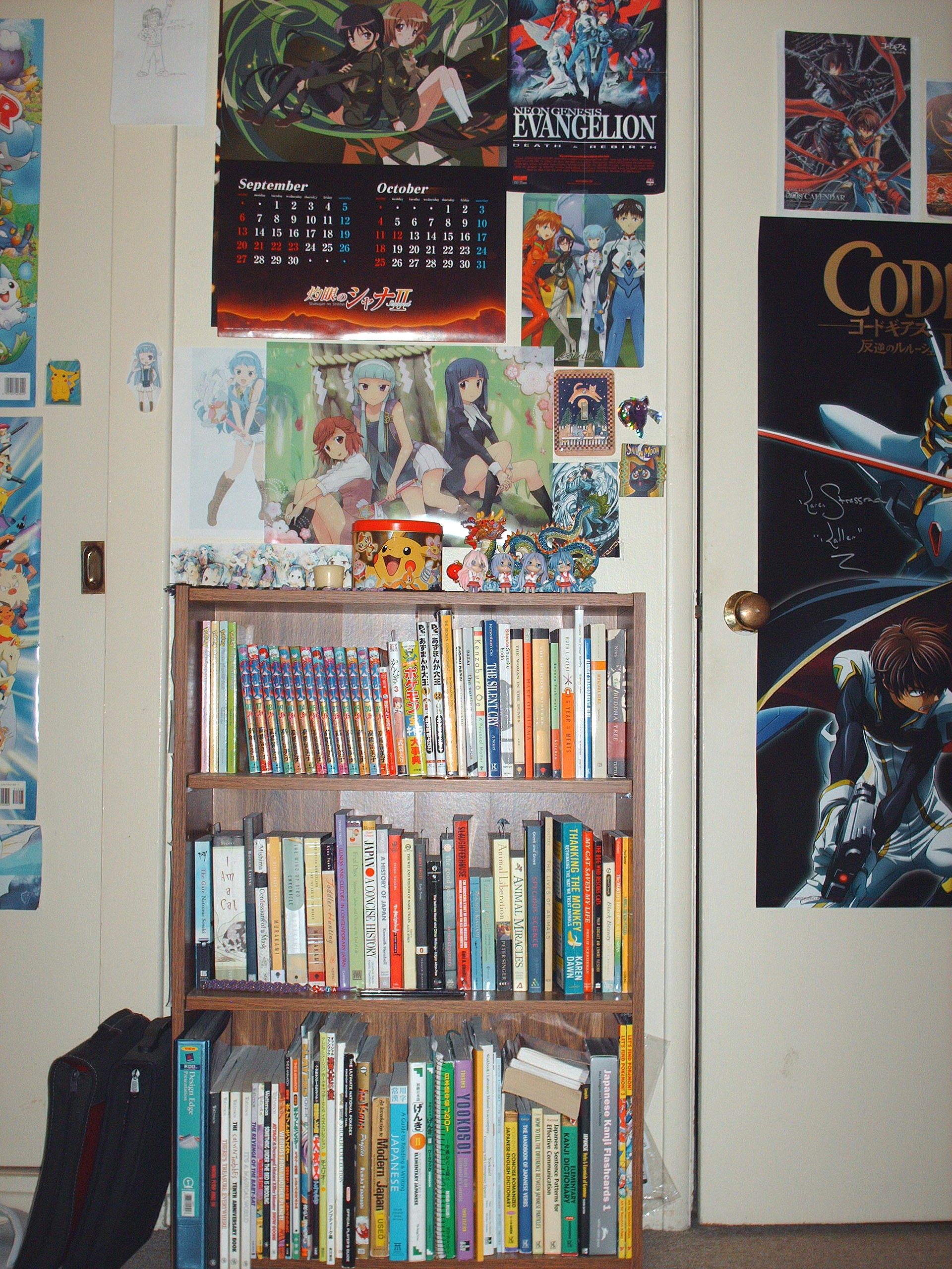 My Bookshelf Each Year I Get A Different Anime Import Calender And This Years Is Shakugan No Shana Which You Can See Hanging Above